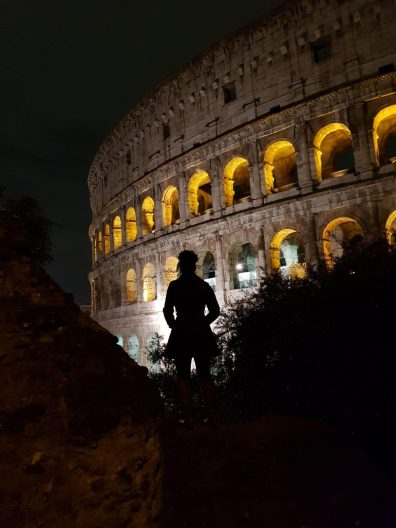 Silhouette in front of the Colosseum